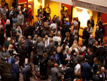 Hundreds of AFP members and guests mingling in the hotel lobby before the start of the National Philanthropy Day event in 2018