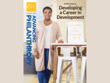 "Cover of April 2020 edition with young black woman standing in office ""Developing a Career in Development"""
