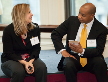 Mentor and mentee sitting and talking at an event