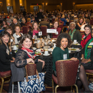 Photo of Girl Scouts sponsor table of attendees