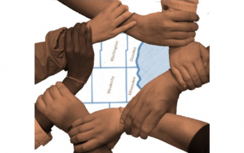 Hands holding wrists to form a circle around county map of southeastern Wisconsin