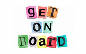 """get on board"" written on colorful pieces of paper one letter per color"