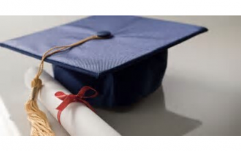 photo of mortarboard graduation cap next to a scroll with a red ribbon tied around it