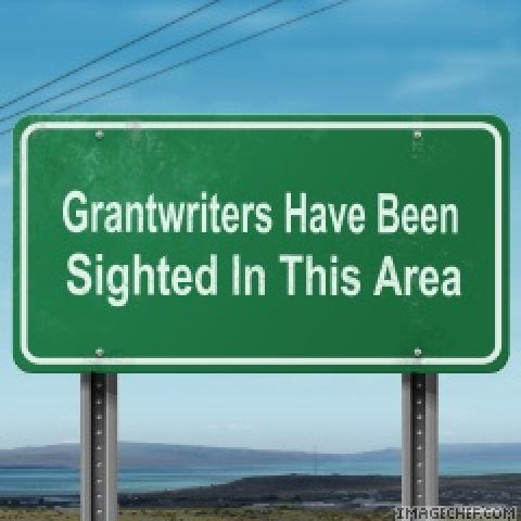 "Highway sign with words ""Grantwriters Have Been Sighted In This Area"""