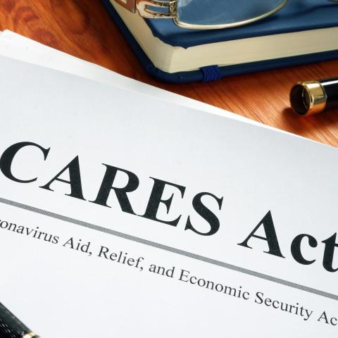 """CARES Act"" document with pen"
