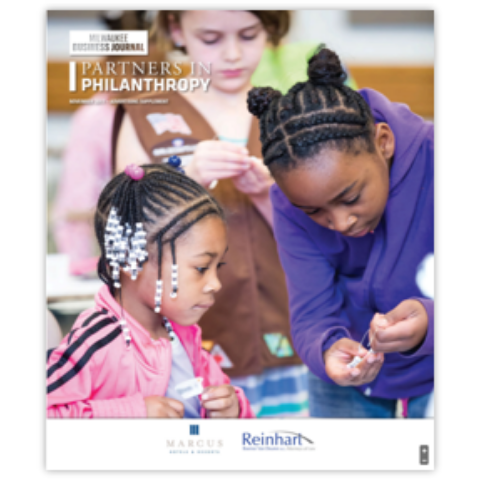 Cover of Milwaukee Business Journal's 2019 Partners in Philanthropy magazine with image of two young black girls working on a crafts project together