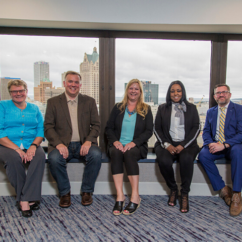 Six 2018 AFPSEWI leaders posing for photo with skyline of Milwaukee in background