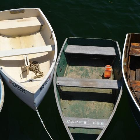 image of small wood boats tied together in a harbor