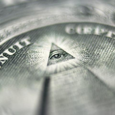 Close-up image of the pyramid with an eye on the US dollar bill