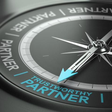 "compass with arrow pointed to ""trustworthy partner"""