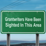 "Street sign that says ""Grantwriters Have Been Sighted In This Area"""
